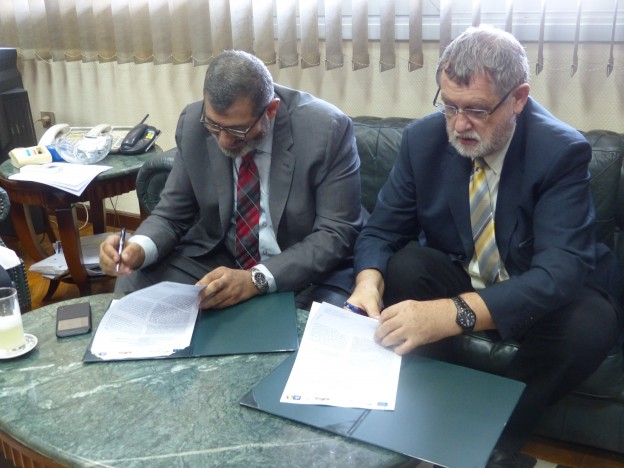Dr. Wehenpohl and Dr. El Zahabi while signing the agreement