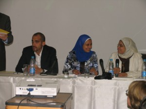 Tawfik Elkheshen (left) of PDP's Local Initiatives Unit, Amira Hossam (center) of the PDP office in Manshiet Nasser, and Yasmine Yehia (right) of the Local Initiatives Unit take turns at reading from the new publication.