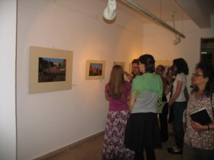 Guests venture out into the exhibition space to see photographs taken by Claudia Wiens.