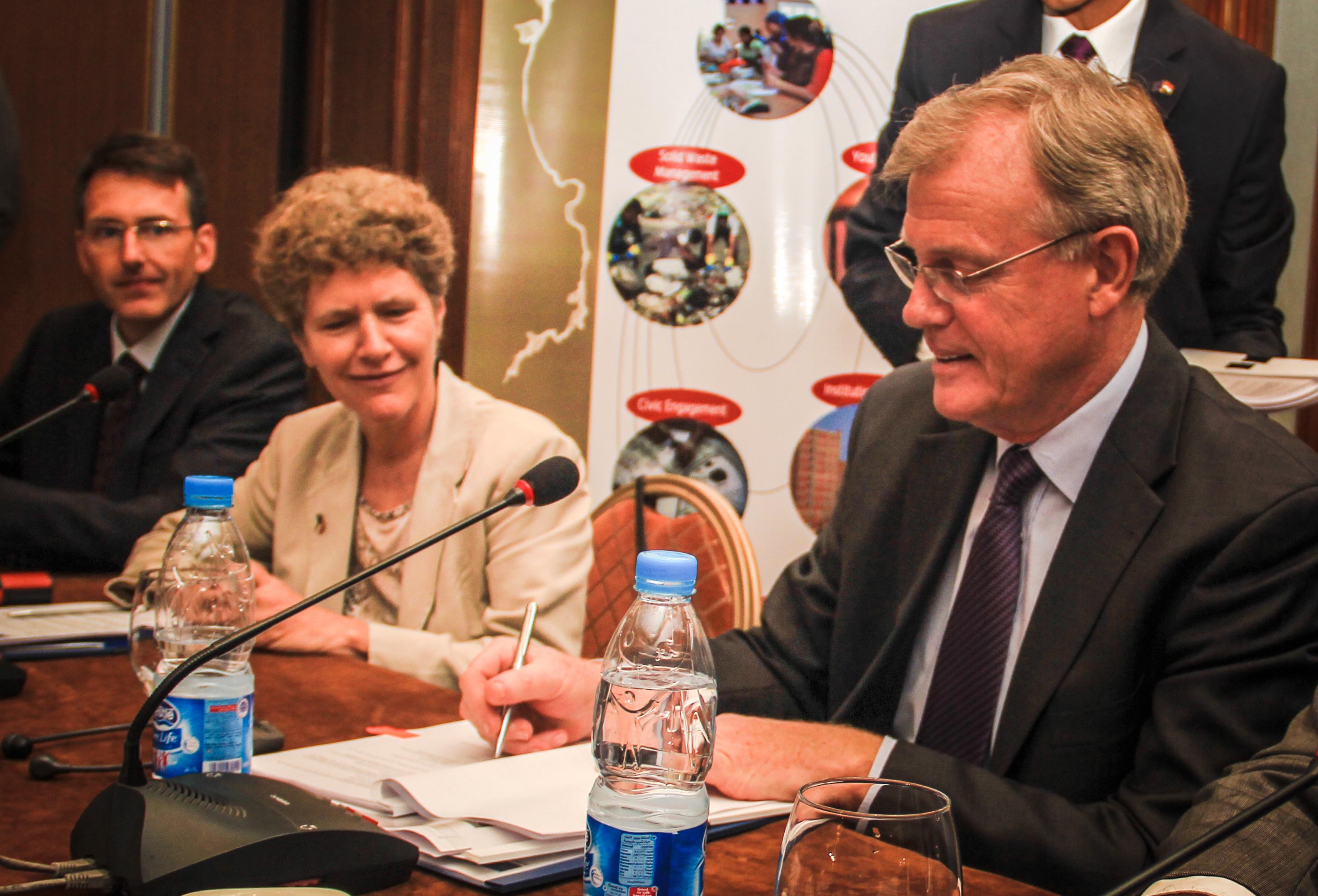 EU Ambassador James Moran with Maria Schäfer (GIZ) signing the cooperation agreement
